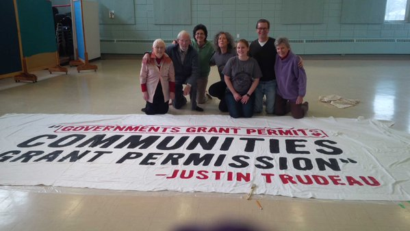 Group photo with large banner