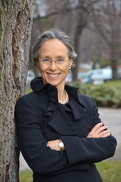 Picture of Dr Dianne Saxe standing beside a tree